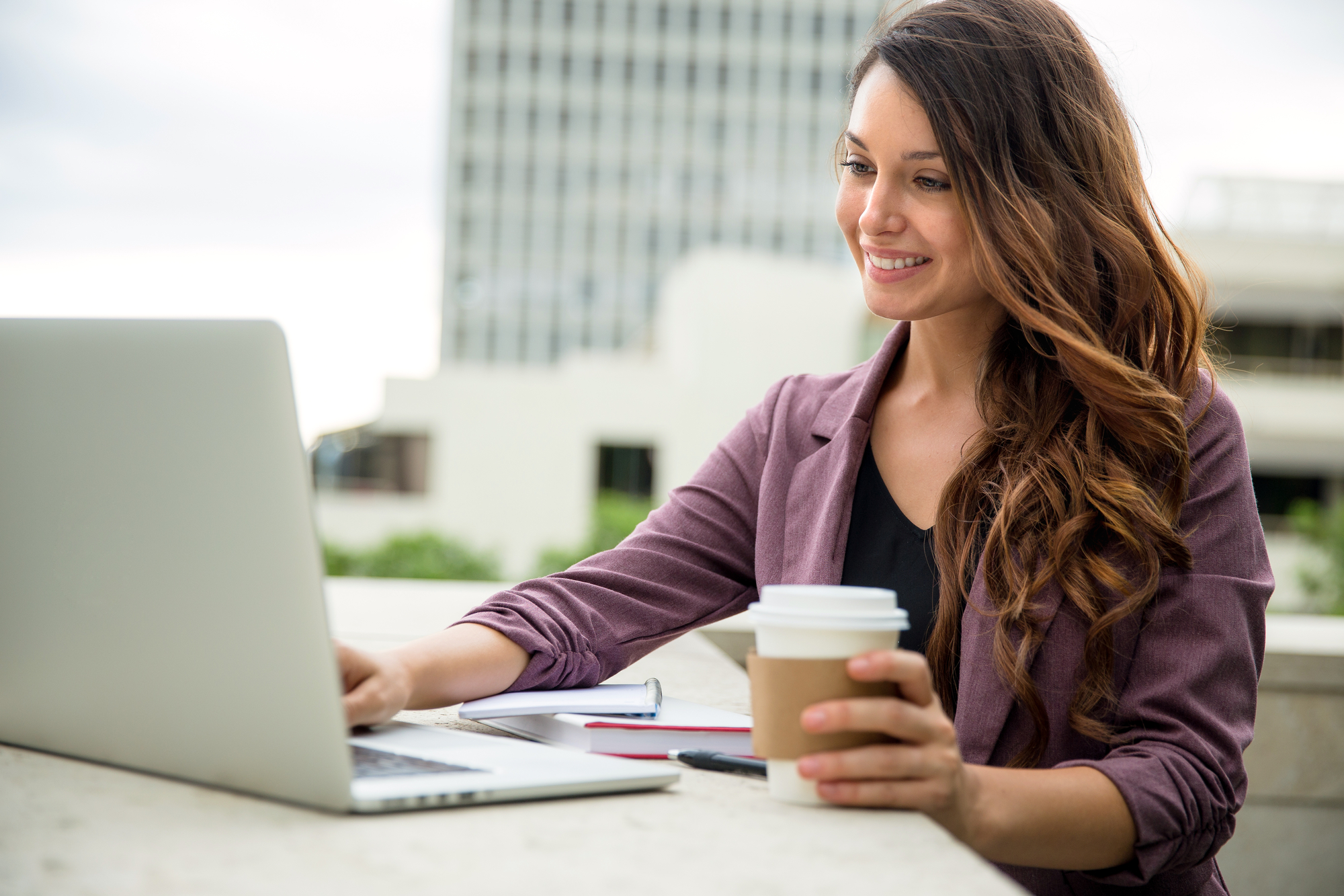 woman working on her laptop. How to save money when you have no money to save