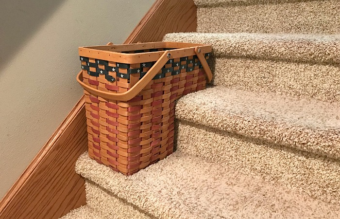 basket on the stairs. how to live clutter free
