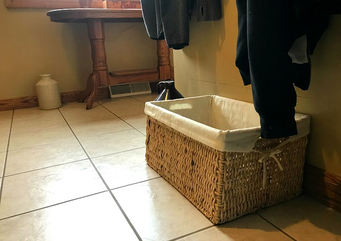 basket in a mudroom. my best decluttering tip