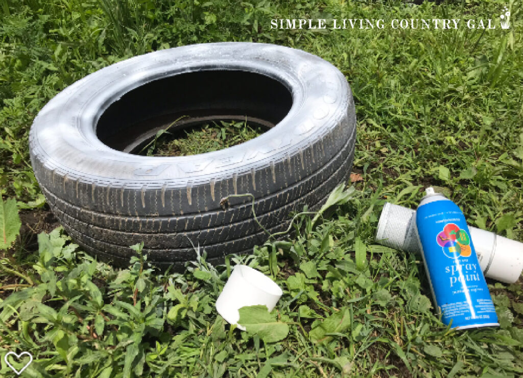 painting a tire for dust bath