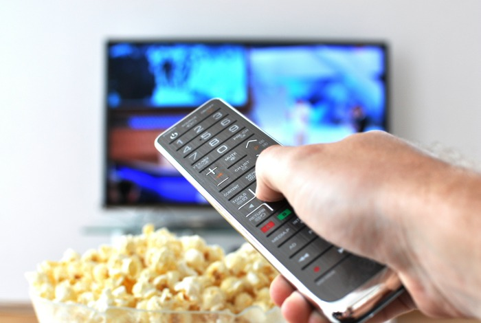 Watching TV with popcorn and a remote. How to ditch satellite TV and save big money.