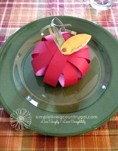 A floral pumpkin place setting. How to save money on thanksgiving dinner