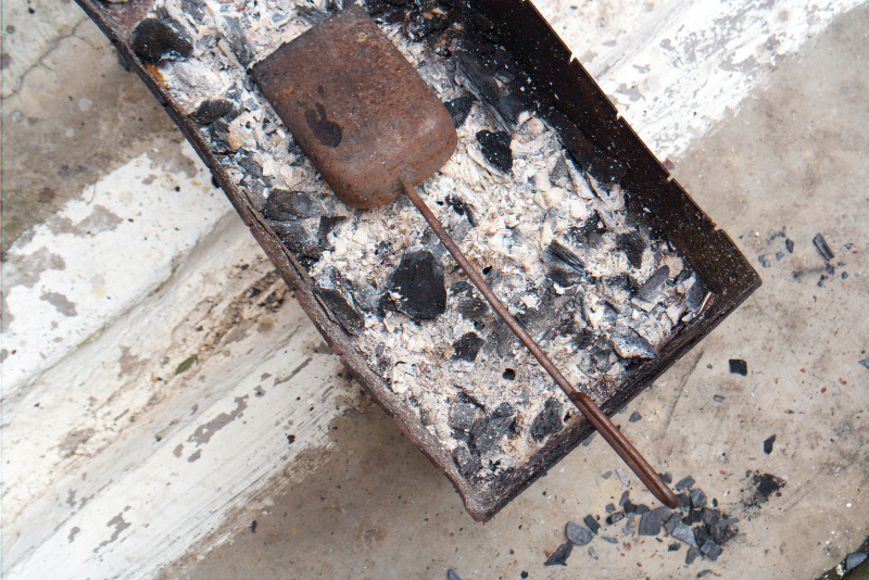 scoop wood ash into your garden for healthier plants and soil