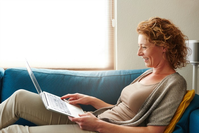 woman on laptop. Choosing the perfect niche for your blog.