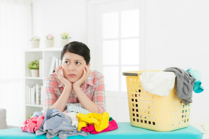 Frustrated women doing laundry. Organizing solutions that work.