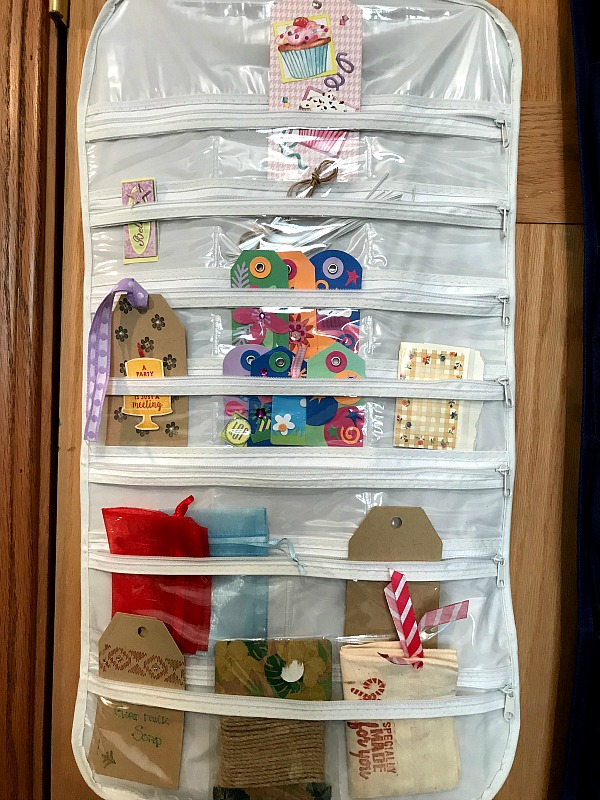 a jewelry organizer on a door used to hold gift tags
