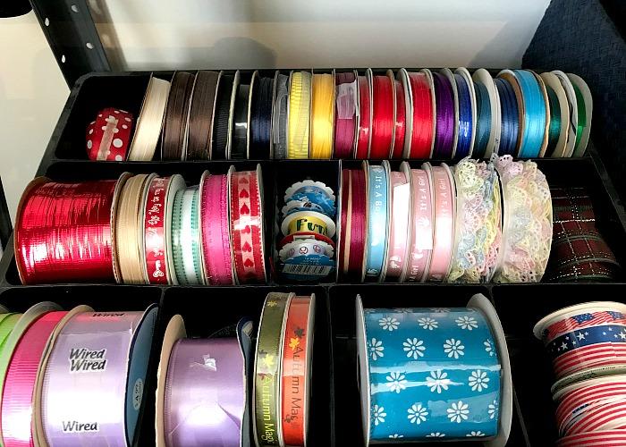 black desk organizer full of colorful ribbons