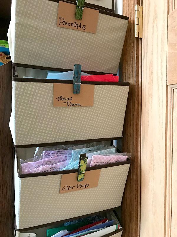 organizing bin hanging on a door full of tissue paper.