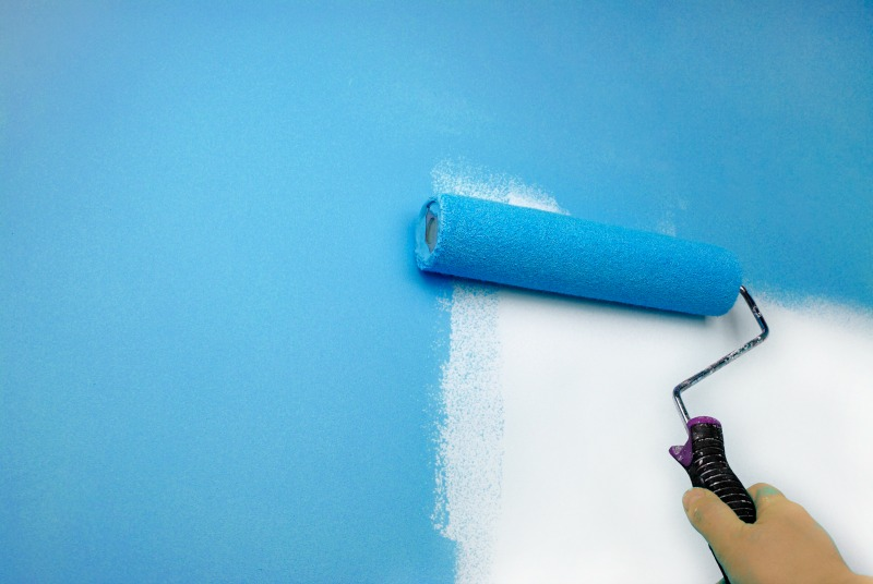 painting a wall as you set up a home office in your home