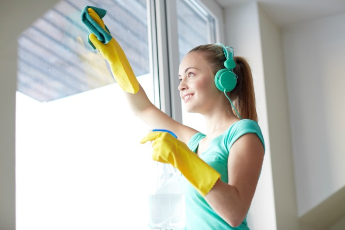 Cleaning a window.Decluttering When Feeling Overwhelmed