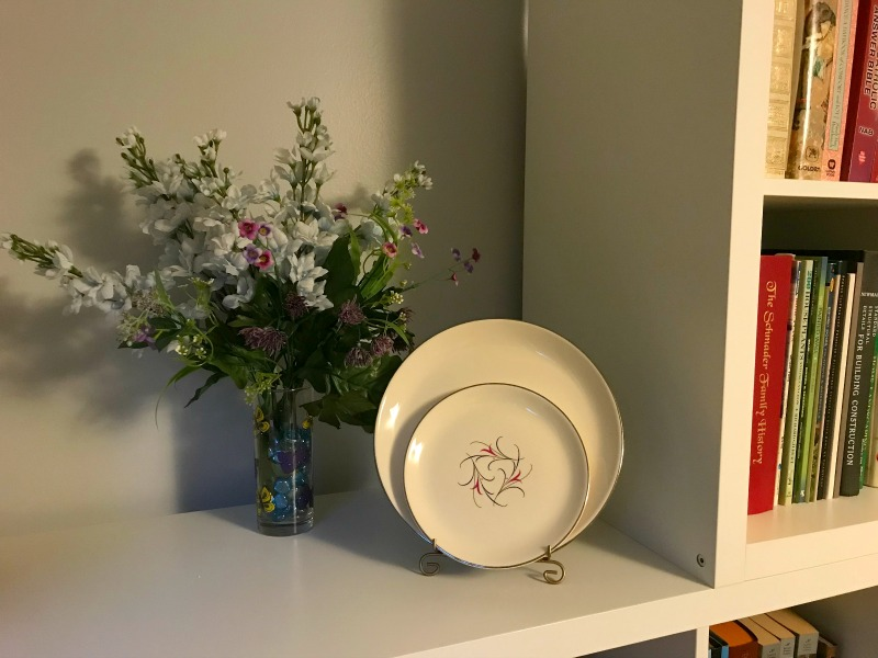 Plates on a shelf. Decluttering rules organizing for beginners