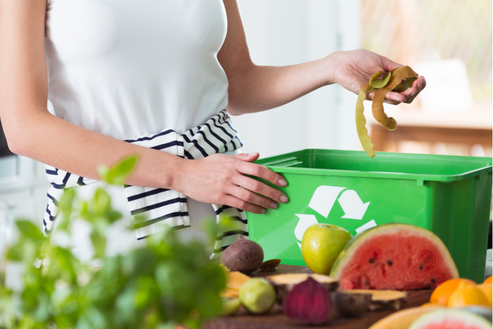 woman composting in a kitchen