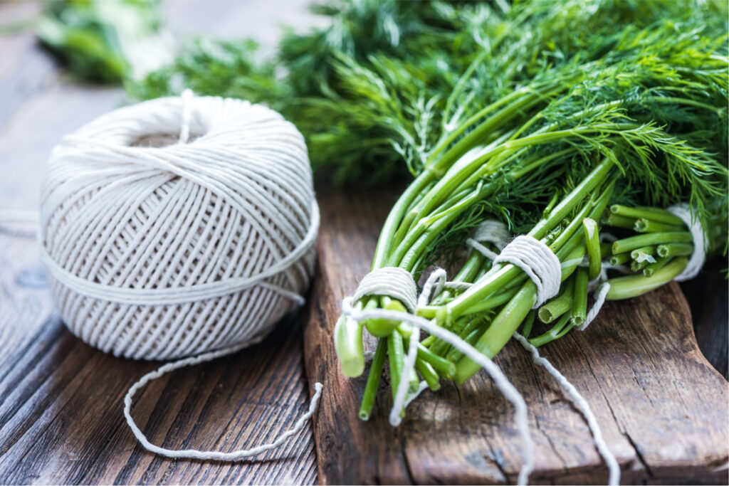 string and herbs tied up so they can dry