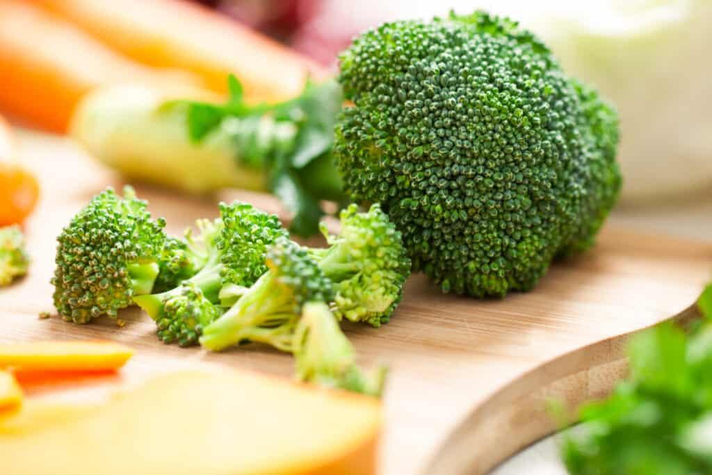 Fresh green broccoli on a cutting board.